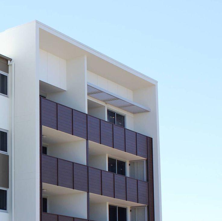 "Balcony railings in Knotwood ""Wenge"" woodgrain aluminum at Anchorage Apartments, Hope Island."