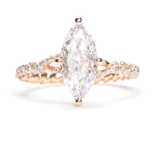 This One Of A Kind Engagement Ring Features Marquis Shaped Center
