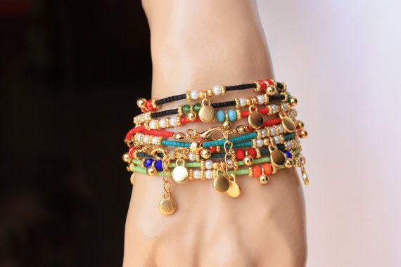 It is an ethnic style bracelet which is decorated red,black,yellow green,dark aqua green afghan beads, 4mm crystals, 3mm glass pearl, gold filled charm and space.Finished also gold filled clap and chain.  It is a great gift and also charming daily wear. Measure: 6.5-7 inches +1/2 extender chain  6xRed= 6 6xBlack= 6 6xAqoq Green= 6 6xYellow Green=6  TOTAL: 24 pcs  This bracelets are ready to send today. Please except the items with in 15 to 20 (2-4 weeks) business days because of…