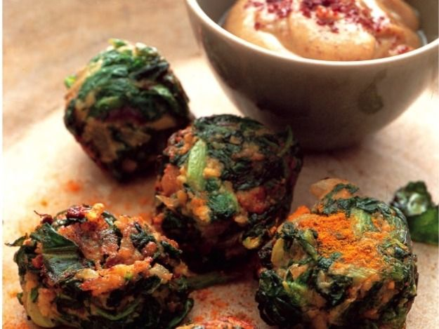 I'm a fan of the falafel, the bright green variety. The crisp little chickpea fritters are brightened up with tons of finely chopped parsley and cilantro, and the added greenery does wonders for what can sometimes be a dauntingly dense sandwich. Silvena Rowe, author of Purple Citrus & Sweet Perfume has taken the green falafel concept one step further with these fantastically light Crunchy Red Swiss Chard Falafel.