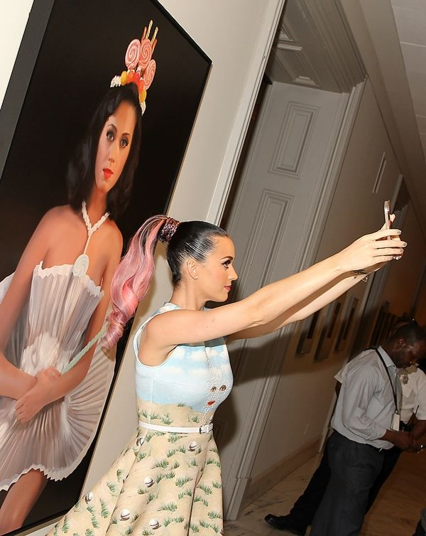9/16/14 - The chairman of Arts Council England is calling on museums and galleries to institute a no-selfies hour every day. Shown, Katy Perry taking a selfie in front of Will Cotton's Cupcake Katy at the National Portrait Gallery.