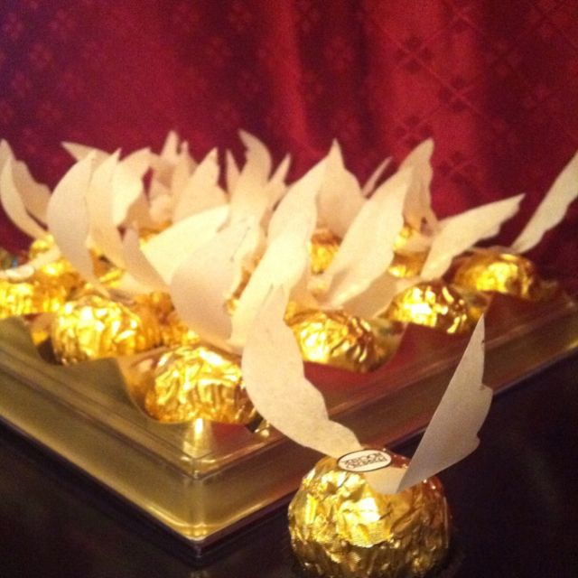 Ferrero Rocher Snitches. Parchment paper for the wings, attach using the sticker that comes on top of every Ferrero Rocher. Easy and awesome gift