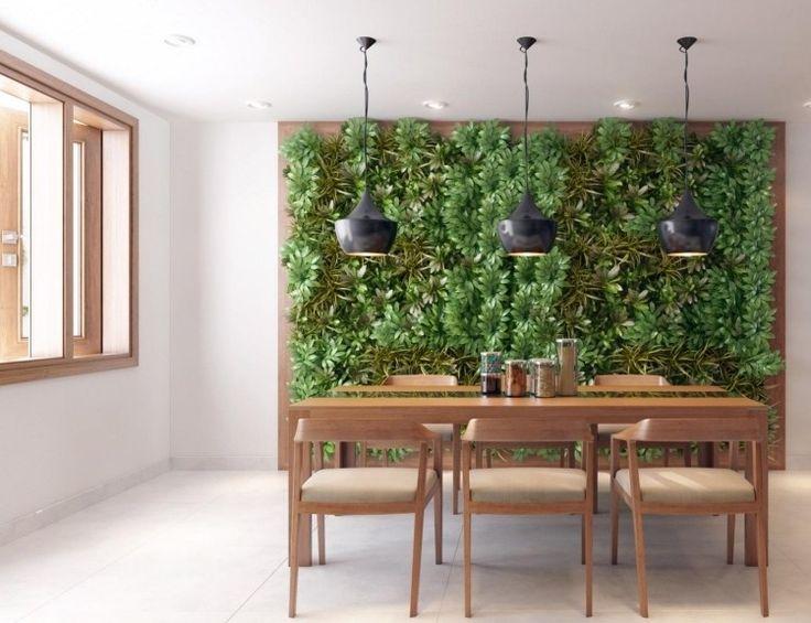 meubles salle manger en bois et mur végétal intérieur