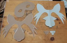 Finally my lovely droogs we come to the final mask in this set the Fox… I created as you can see the fox in the same fashion as the bear and the owl. Although I have to say this mask was a bit of a challenge… Figuring out what type of shape of tag to put on the sides of the fox snout had me going; I made five blue stencils before getting it right and even then it took me a little more time futzing and trimming. I managed to glue the snout part on a little bit wrong so one eye isn't the…
