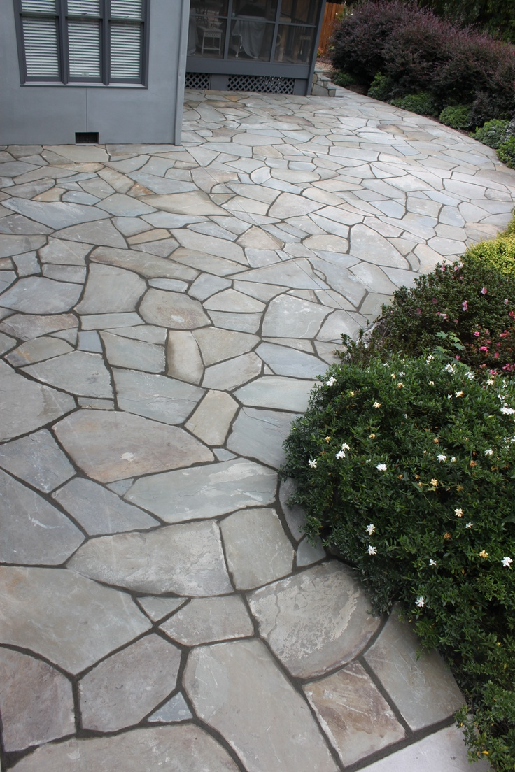 I would like to cover the concrete patio with stone or tile.
