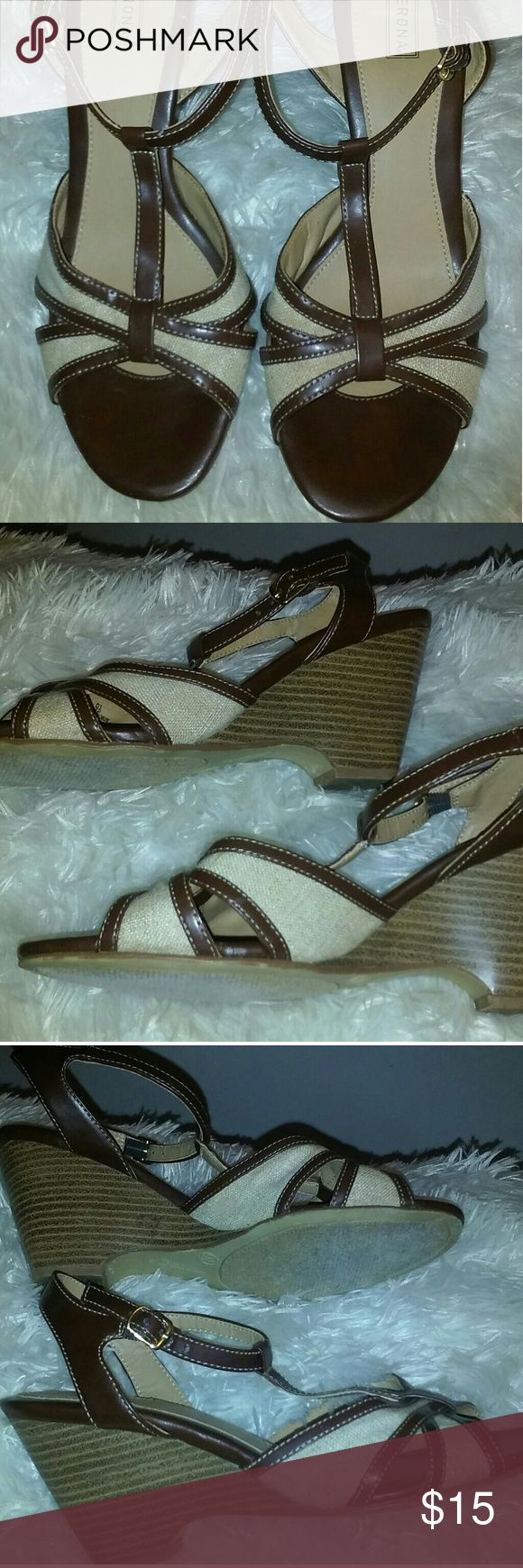 "Merona Brown & Tan Wedge Sandals Size 9.5 Nice pair of neutral wedge sandals by Merona.  Size 9.5 in great condition.  Worn once.  Buckle wrap around ankle with strap.  Wedges are faux wood and 3"" high.  Thanks for looking! Merona Shoes Wedges"