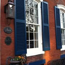 navy shutters on red brick - if we don't paint the brick