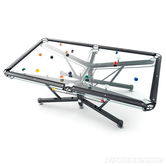 Glass Pool Table. Surface is topped with a patented Vitrik playing surface that replicates the traditional felt cloth. Neato.