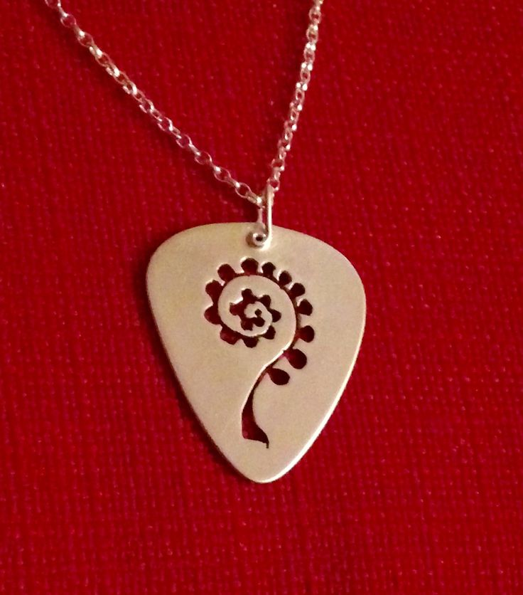 Made by Helen Green - silver sheet 0.8mm pick with Fern hand cut by saw (don't look to close :0( ) for Fern's birthday.