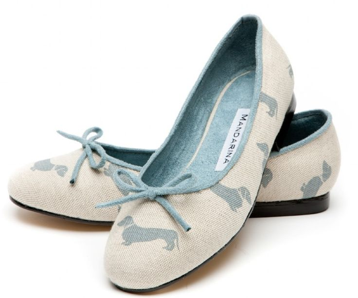 Blue Dachshund Print Pumps (they come in red too). Too bad they are 93 pounds (UK).
