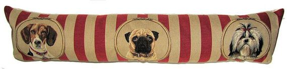 """This tapestry draught excluder cushion shows a pug, a beagle and a shihtzu. It was designed by co-owner Sabine and is woven on a jacquard loom. Tapestry design is a craft that only a few master and Sabine is one of them. She starts from a high resolution image, which she scans and then comepletely reworks it until it is ready for weaving. Averagely, the """"cleaning up"""" of an image takes between 12 and 16 hours. Respect !    The cushion is woven with 100% cotton thread. It is lined with a plain…"""