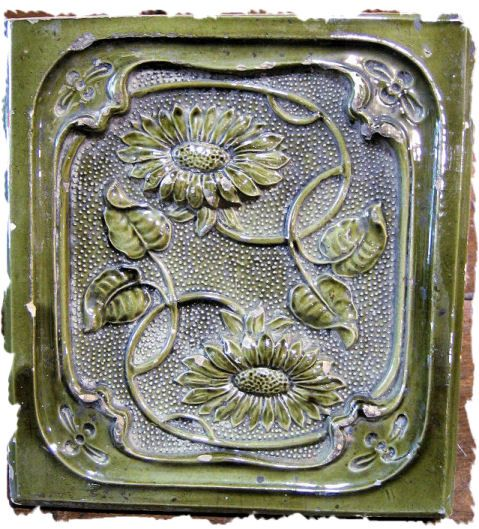 """Lovely stove tiles from Romania. Measuring about 8"" x 9"", they were fit together to form walls radiating heat in the corner of a room where the soft greens and art nouveau sunflowers combined to bring the garden into the home. You can have summer all year long!"""