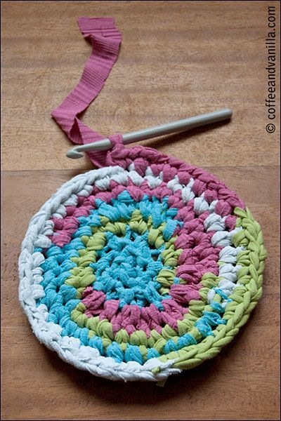 Recycled T-shirt Carpet. i am always making rag rugs.   I just tie the pieces together and the knots dont really matter. always take a ball of torn rags in the car and work on the rug when i am a passenger.