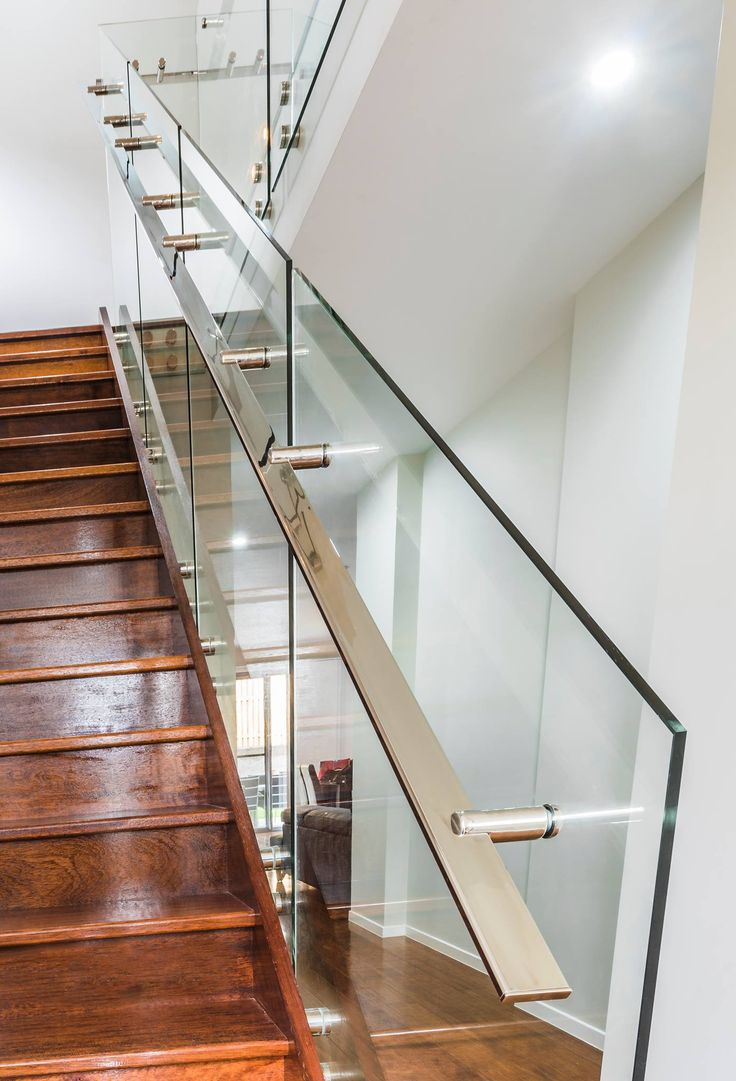 Glass balustrade with stainless steel stand-offs and custom made handrails