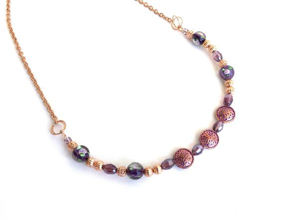 I created this feminine rose gold plated chain necklace with different types of beads in rich purple and lavender shades - for those who like to feel like royalty when they wear their jewelry! I used three purple metal beads with rose gold tone foiling, floral lamp work beads,
