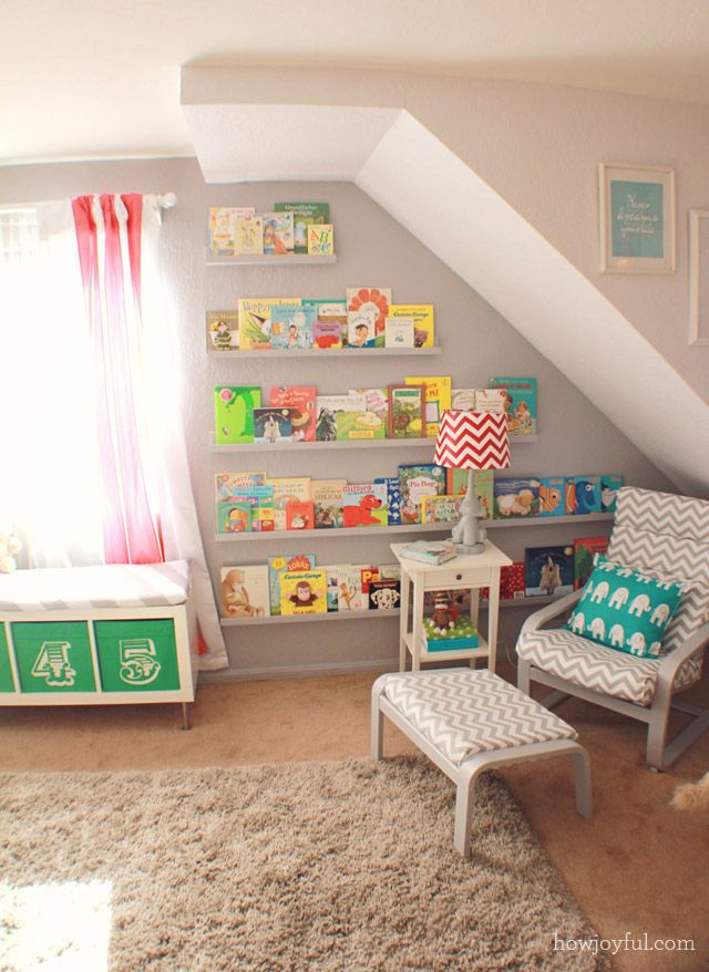 We love the library wall they created for this awkward wall in the nursery. Perfection! #nursery #librarywall: Bookshelves, Idea, Circus Gender, Reading Corner, Book Shelves, Ikea Chair, Baby, Gender Neutral Nurseries, Kids Rooms