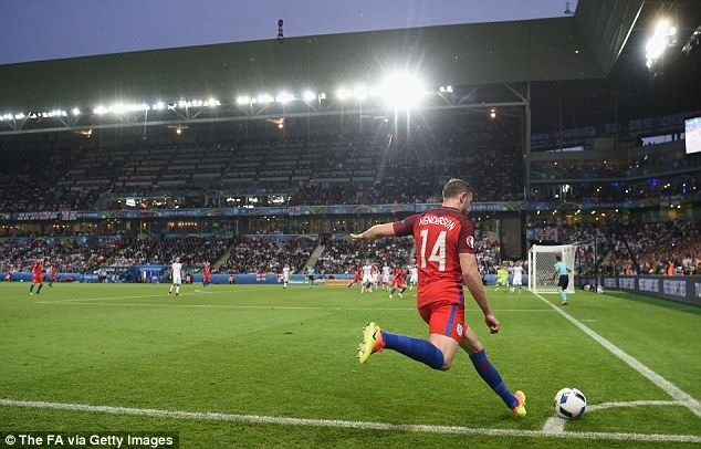 Jordan Henderson sends a corner into the Slovakia penalty area during England's goalless draw on Monday