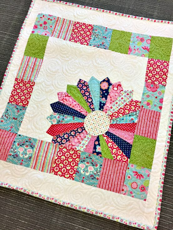 Are you looking for an easy baby quilt pattern? Why not try this adorable Dresden Window Pane pattern. This quilt features Flutterberry fabric line from Riley Blake Designs.