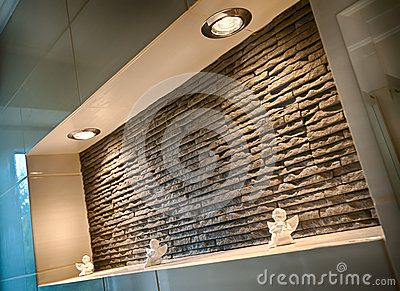 Wall recess in a bathroom made of sandstone tiles.