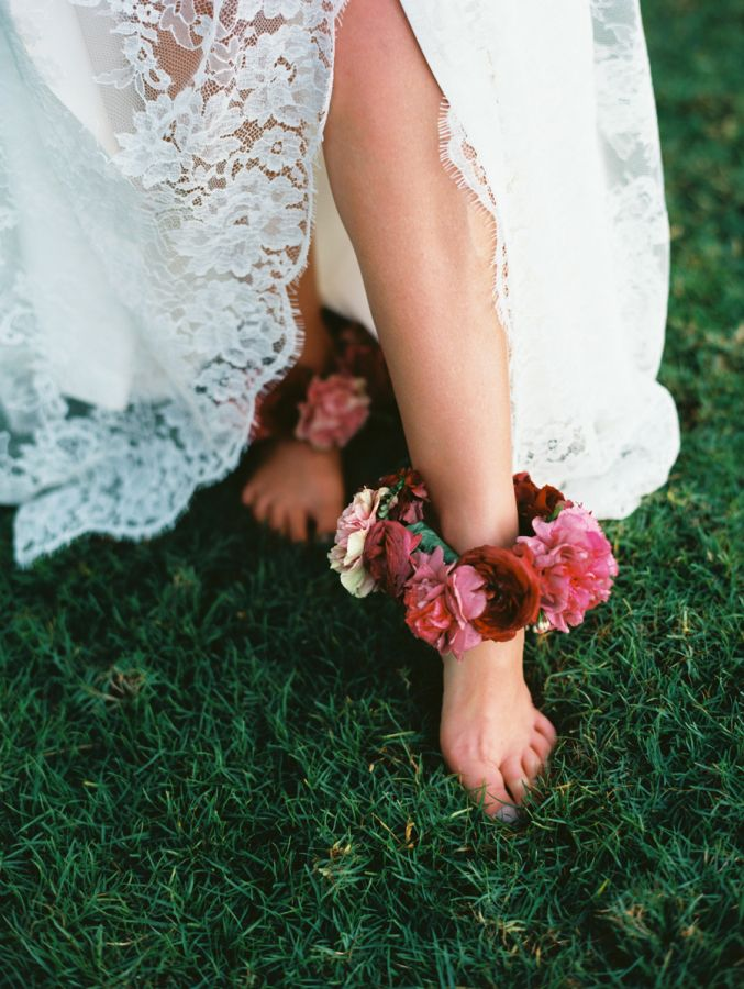 Traditional Hawaiian ankle lei: http://www.stylemepretty.com/destination-weddings/hawaii-weddings/2016/05/19/this-hawaiian-wedding-is-what-destination-wedding-dreams-are-made-of/   Photography: Wendy Laurel - http://www.wendylaurel.com/