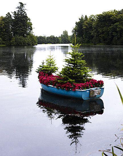 GArden idea for a lake garden.....Romantical!!! Christmas in a boat....I love it!