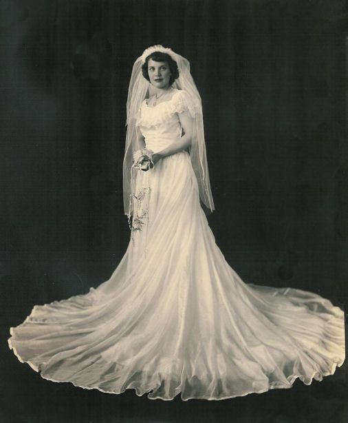Clara Keith Fitchett married David R. Ketelhut on May 31, 1944, Hampton, VA, in her parachute silk wedding dress.