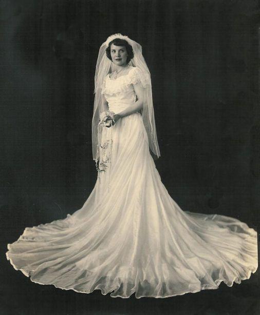 Clara Keith Fitchett married David R. Ketelhut on May 31, 1944, Hampton, VA, in her parachute silk wedding dress.