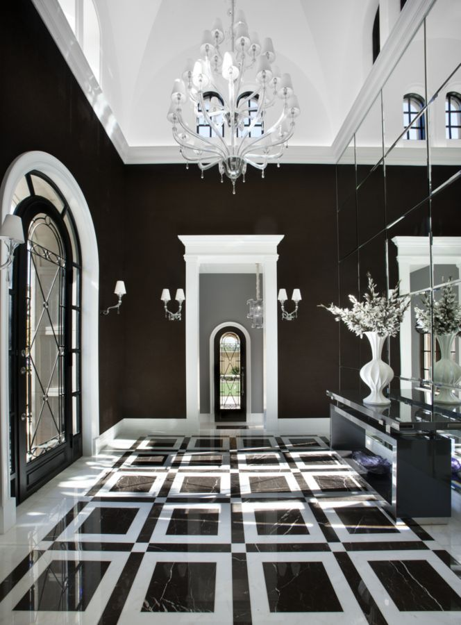 This stunning black and white entryway was completed by Salcito Custom Homes. #luxeAZ