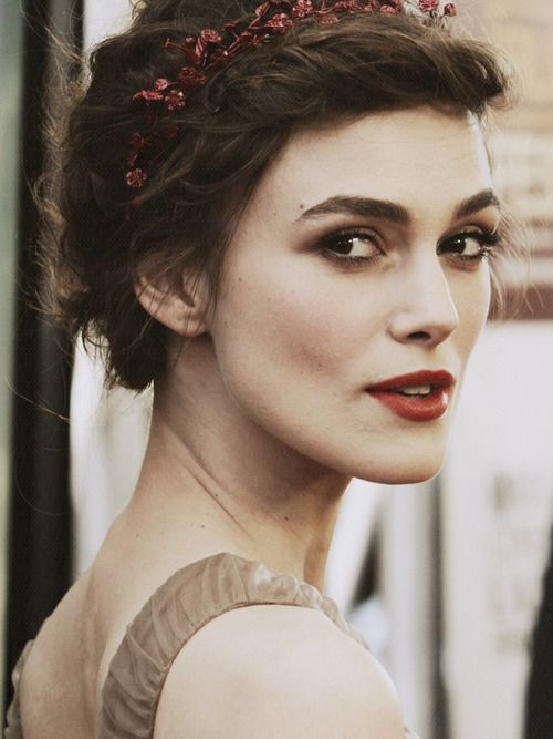 I know she's the modern actress, Keira Knightly, but her makeup, hair and clothing (what little can be seen) reminds me of an era gone by...