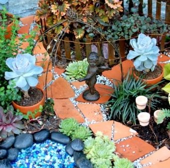 Miniature Fairy Garden with terracotta walk way, planted in the Main Garden at Natureworks.