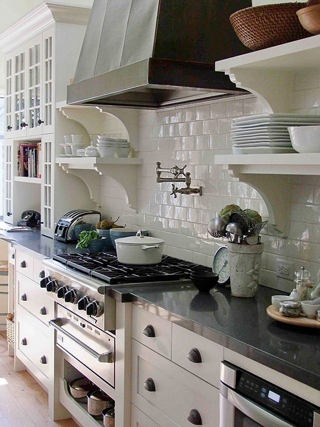 Kitchen Ideas - this is a great post with lots of different kitchen styles & designs. love this range hood pictured