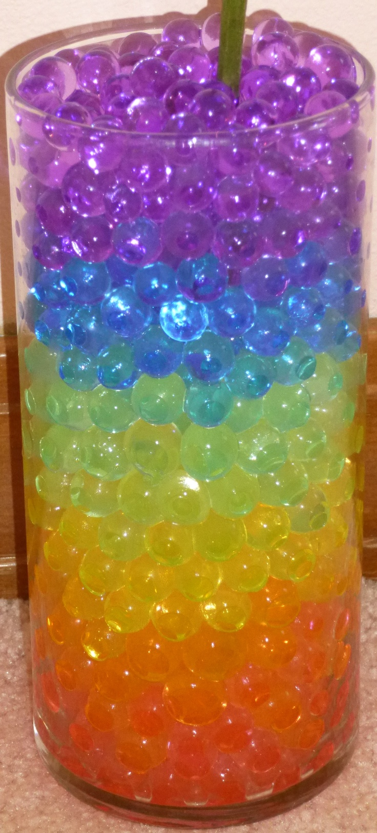RAINBOW LAYER water beads hydrated absorbing gel, Magic marble crystal orbeez for plants and flowers. Keeps plants watered for 2-4 weeks (depending on the environment). * Highest Quality, Colorfast, Odorless, Non-molding and Non-Toxic. Great for wedding centerpieces! 12 colors available: Green, Teal, Black, White, Clear, Rainbow Mix, Purple, Pink, Orange, Yellow, Coral-Red and Blue. To purchase: www.giftsbyabigail.com/water-beads .... 9 cups of water beads for only $12.00 w/ FREE SHIPPING!!!