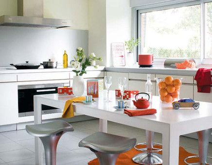 Colorful kitchen and dining. www.remodelworks.com