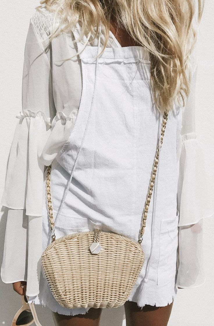 All white with a straw crossbody.