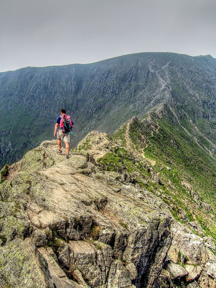 On Striding Edge with Helvellyn beyond, Lake District, England by Paul Thickitt