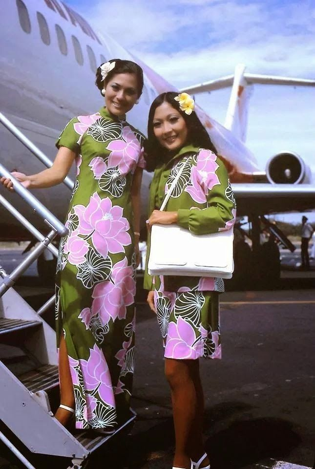 1977. Again designed by Malia International, Ltd., this uniforms included a jump suit, a long muumuu, jacket, solid scarf and print scarf.