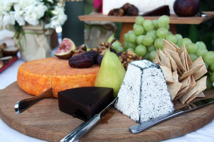 grazing tables covered in cheeses and other delicious and pretty things...what's not to love?