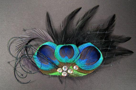 Gothic mini veil black feather headpieces peacock eye dark birdcage goth bird cage veil feathers hair pieces. $43.00, via Etsy.