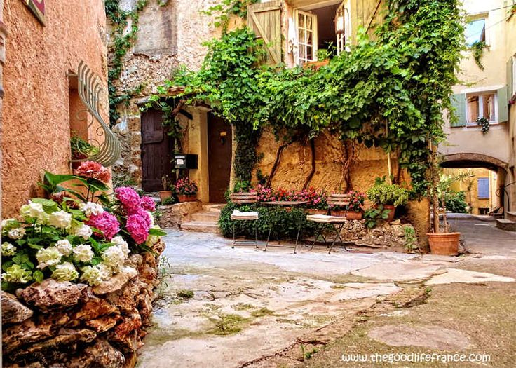 Cotignac, Provence. The town dates back to Roman times, the Romans no doubt drawn to the sunny climes and excellent terroir in which the famous vines grow to this day. Village life evolves around the long Cours Gambetta, a raised pedestrian road on the west side with cars on the east side.