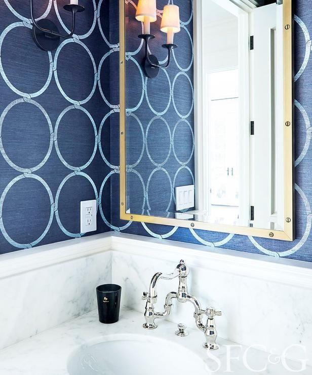 navy grasscloth wallpaper and gold rivets mirror bathroom