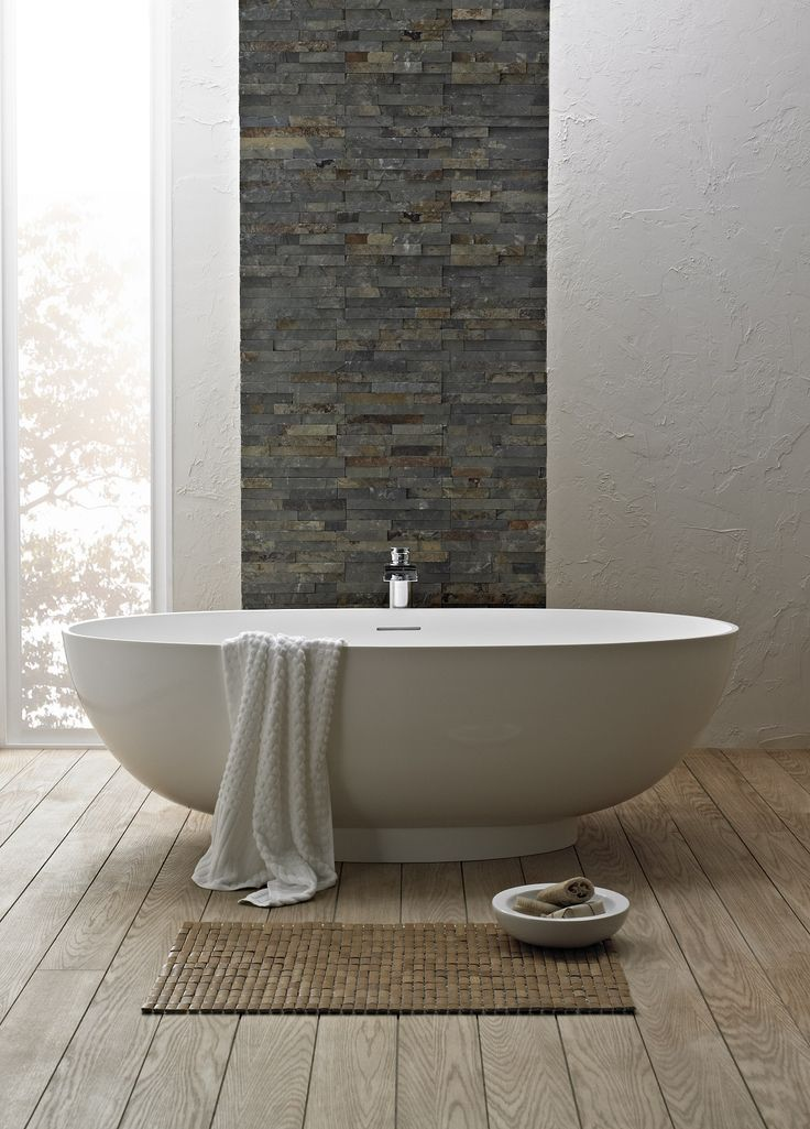 Freestanding tub, floors and textured wall. Would look better in a corner