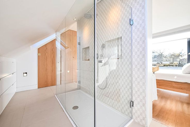 Claudia Urvois Interior Design Kensal Rise Residence Master Bathroom space saving solution for under the eaves large double shower with his and her niches and Azulej Trevo Bianco from Mutina tiles