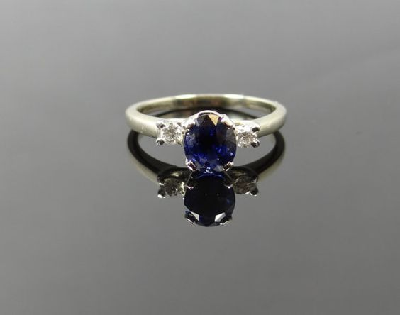 http://rubies.work/0886-sapphire-pendant/ Simple White Gold Three Stone Diamond and Navy Blue Sapphire Ring: Sparkly Navy Blue Dress