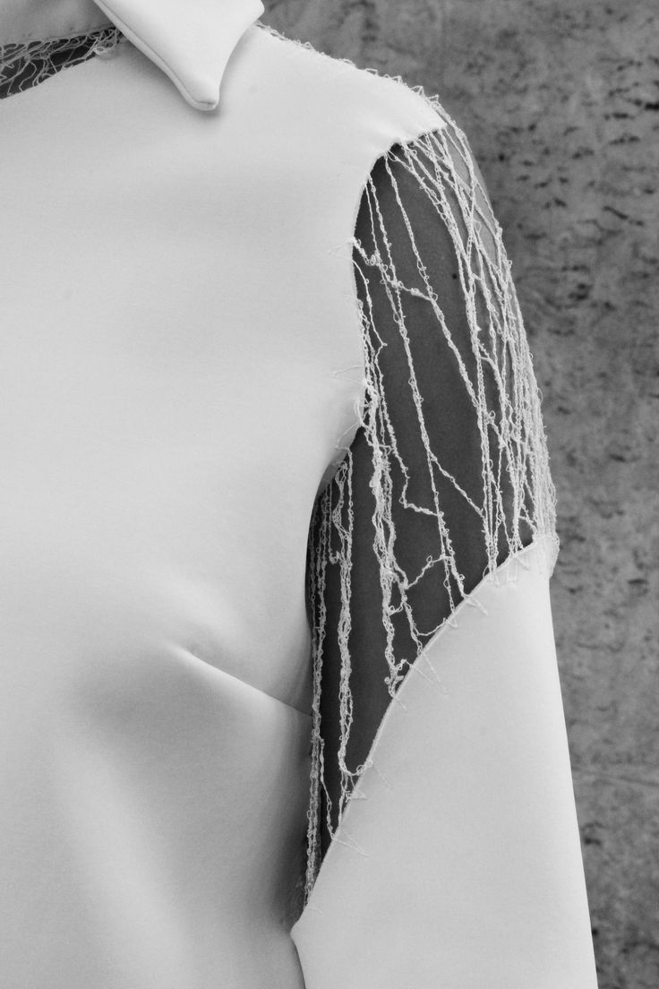 White neoprene shirt sleeve detail, sliced & suspended; deconstruction; innovative fashion design // Clara Bondon @castaner