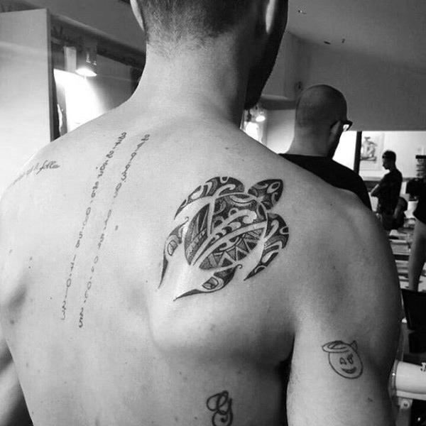 Guy With Swimming Turtle On Shoulder Blade Tribal Tattoos border=