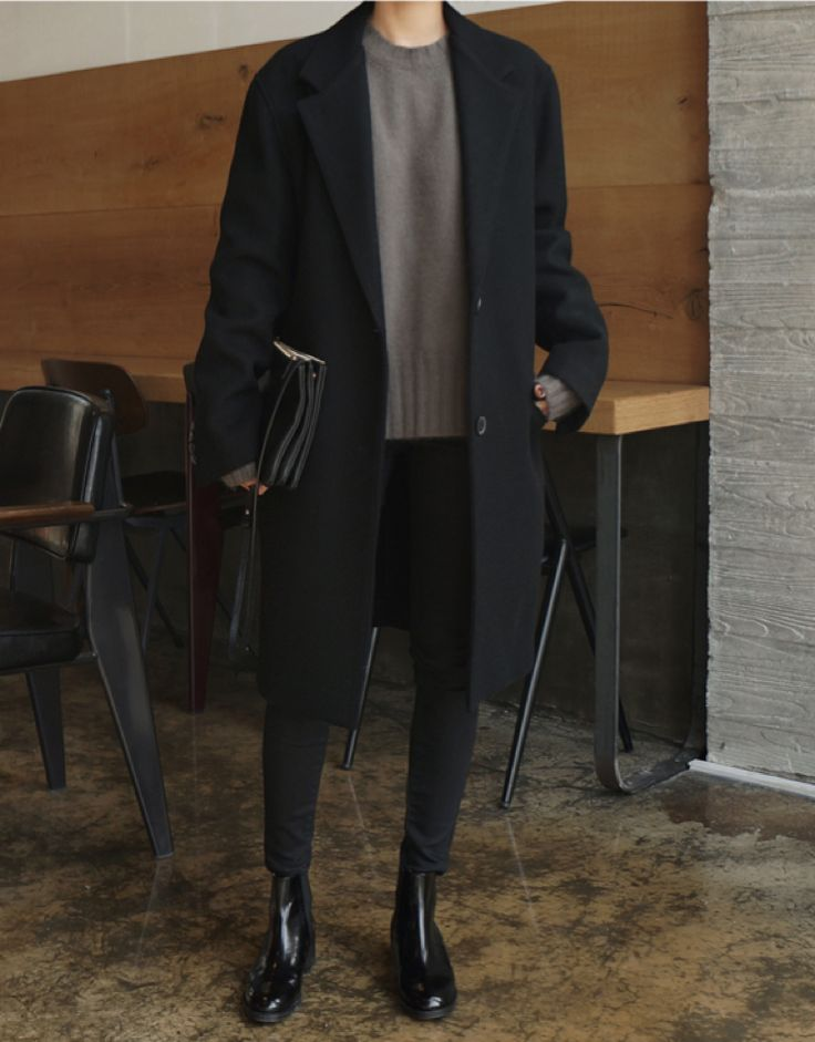 grey sweater, black overcoat, black trousers, black leather booties