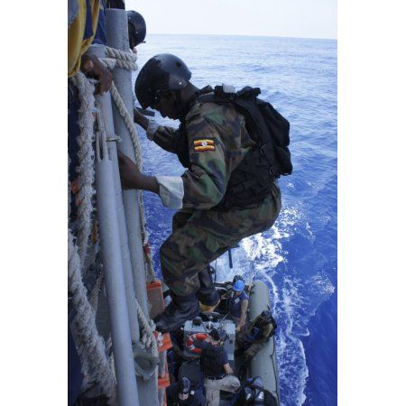 A marine from the Uganda People?ج欥?ج欆?ج欥s Defense Force descends a US Navy ship Canvas Art - Stocktrek Images (23