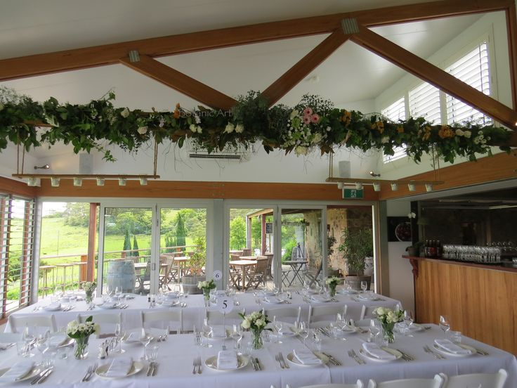 beam decoration, flower garland, barn wedding, ceiling draping, table vases, white flowers, peach flowers, country chic, elegant wedding, floral affair, winery #Cupitts