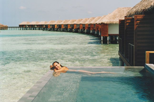 The spa pool at Velassaru (www.velassaru.com) in the Maldives, with over-water villas stretching into the sea.