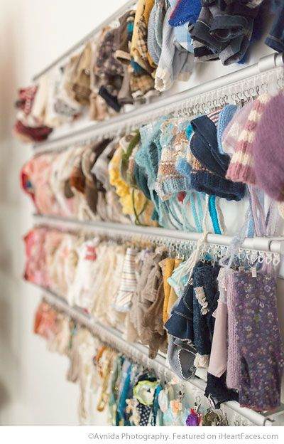 Side view of Rail and curtain hook organizing system for hats and headbands - Avnida Photography's beautiful studio featured on I Heart Faces Photography Blog